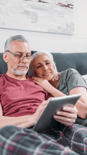 no more snoring dental medicine providers happy older couple iPad